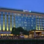 What are the check-in and check-out times at Radisson Blu hotel?
